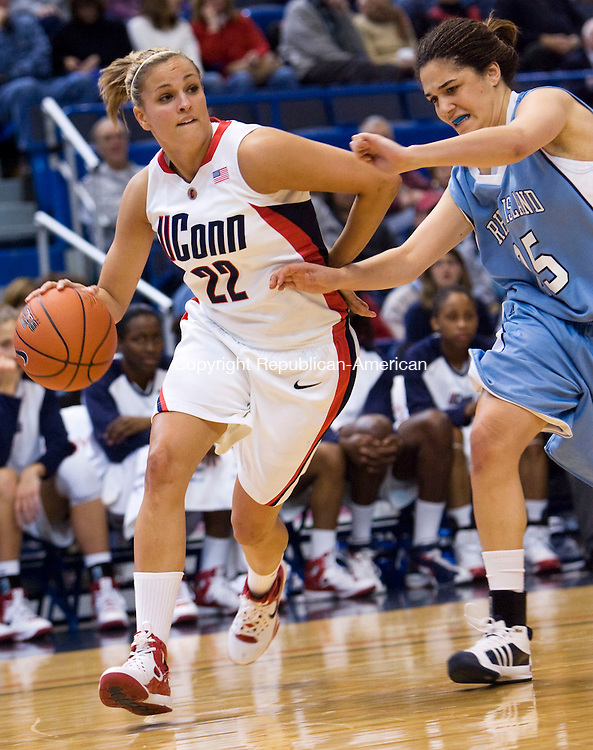 HARTFORD, CT - 22 NOVEMBER 2008 -112208JT11-<br /> UConn's Meghan Gardler dribbles past Rhode Island's Lara Gaspar during Saturday's game at the XL Center in Hartford. The Huskies won, 91-43.<br /> Josalee Thrift / Republican-American