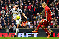 Sunday, 23 February 2014<br /> Pictured: Swansea City's Jonjo Shelvey shoots at goal<br /> Re: Barclay's Premier League, Liverpool FC v Swansea City FC v at Anfield Stadium, Liverpool Merseyside, UK.