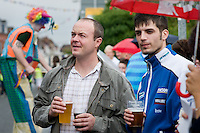 Barwell Carnival.??Male spectators holding pints of beer while watching the parade.??Date Taken:?21/08/10??Location: Barwell, near Hinckley, Leicestershire??Commissioned by: Paul