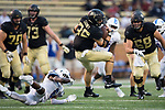 Cade Carney (36) of the Wake Forest Demon Deacons spins away from a hit by Michael Fisher (6) of the Presbyterian Blue Hose during first half action at BB&T Field on August 31, 2017 in Winston-Salem, North Carolina.  (Brian Westerholt/Sports On Film)