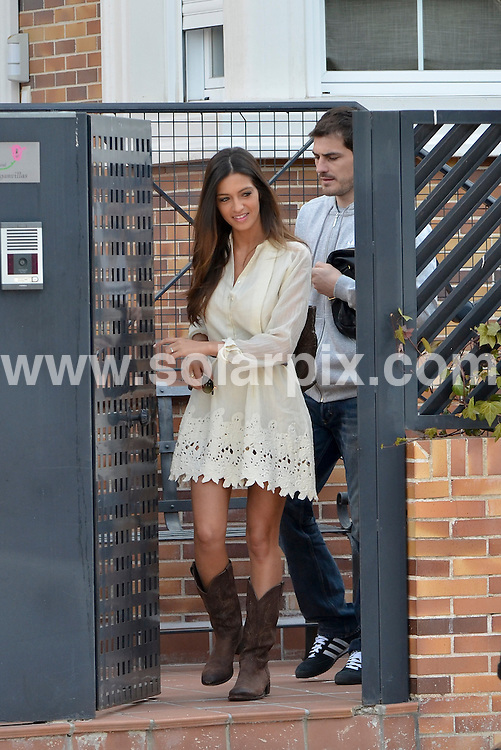 **ALL ROUND PICTURES FROM SOLARPIX.COM** **DOUBLE SPACE RATES APPLY**                                                                                                                                             **WORLDWIDE SYNDICATION RIGHTS EXCEPT SPAIN - NO SYNDICATION IN SPAIN**                                                                                  Caption:  Spain & Real Madrid Goal keeper Iker Casillas and reporter Sara Carbonero seen leaving their madrid home today.The couple plan to get married in July, after the Euro..Carbonero, 28, and Casillas, 30, have been dating for three years and the Real Madrid captain had already proposed several times,                                                                             This pic:  Iker Casillas & Sara Carbonero                                                                                            JOB REF: 14571       ROL       DATE: 15.03.2012                                                           **MUST CREDIT SOLARPIX.COM OR DOUBLE FEE WILL BE CHARGED**                                                                      **MUST AGREE FEE BEFORE ONLINE USAGE**                               **CALL US ON: +34 952 811 768 or LOW RATE FROM UK 0844 617 7637**