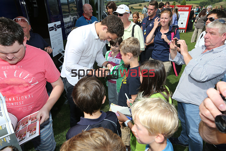 ISPS Handa Wales Open 2013<br /> Celtic Manor Resort<br /> George North signing autographs in the tented village.<br /> 01.09.13<br /> <br /> &copy;Steve Pope-Sportingwales