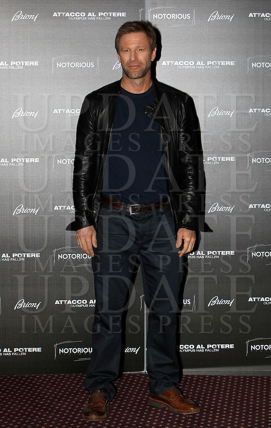 "L'attore statunitense Aaron Eckhart posa durante il photocall del film ""Attacco al potere"" a Roma, 5 aprile 2013..U.S. actor Aaron Eckhart poses during the photocall of the movie ""Olympus has fallen"" in Rome, 5 April 2013..UPDATE IMAGES PRESS/Isabella Bonotto."