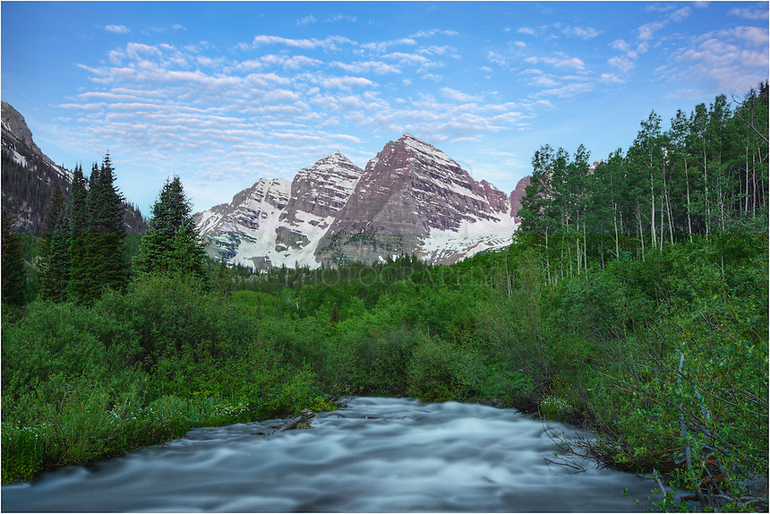 Maroon Creeks runs high in the early summer when the snow is melting. This image from Colorado's iconic Maroon Bells Wilderness area was captured early in the morning. Just before taking this shot of the bells, I saw two porcupines and a moose!