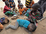Newly arrived Somali refugee children wait to be registered in the Dadaab refugee camp in northeastern Kenya. Tens of thousands of newly arrived Somalis who have swelled the population of what was already the world's largest refugee camp.