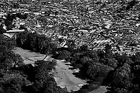 The Kibera slum, bordered by an exclusive golf course. Over 25 percent of Nairobi's population live in Kibera, an area that covers less than one percent of the city. Although the population of the slum is over one million, it is recognised officially as a 'squat', or illegally occupied land, which allows the government to ignore the basic needs of the inhabitants.