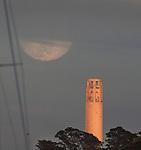 Aprils full moon over San Francisco's Coit Tower
