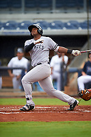 Tampa Yankees right fielder Alexander Palma (18) follows through on a swing during the first game of a doubleheader against the Charlotte Stone Crabs on July 18, 2017 at Charlotte Sports Park in Port Charlotte, Florida.  Charlotte defeated Tampa 7-0 in a game that was originally started on June 29th but called to inclement weather.  (Mike Janes/Four Seam Images)