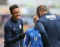 Preston North End's Callum Robinson shares a joke with Tommy Spurr<br /> <br /> Photographer Alex Dodd/CameraSport<br /> <br /> The EFL Sky Bet Championship - Huddersfield Town v Preston North End - Friday 14th April 2016 - The John Smith's Stadium - Huddersfield<br /> <br /> World Copyright &copy; 2017 CameraSport. All rights reserved. 43 Linden Ave. Countesthorpe. Leicester. England. LE8 5PG - Tel: +44 (0) 116 277 4147 - admin@camerasport.com - www.camerasport.com