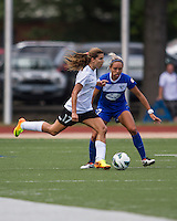 In a National Women's Soccer League Elite (NWSL) match, Portland Thorns FC defeated the Boston Breakers, 2-1, at Dilboy Stadium on July 21, 2013.  Portland Thorns FC midfielder Tobin Heath (17) passes the ball as Boston Breakers forward Kyah Simon (17) defends.