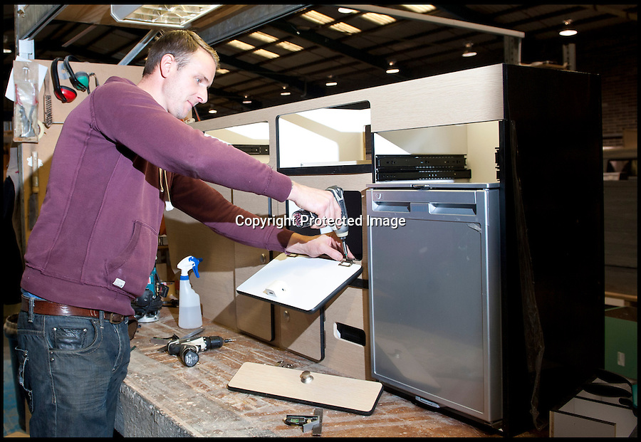 BNPS.co.uk (01202 558833)<br /> Pic: LauraJones/BNPS<br /> <br /> Cabinet assembler James Harman working on a cupboard door.<br /> <br /> The last ever delivery of brand new Volkswagen campervans has arrived in Britain marking the end of an era for the iconic 'hippy bus'.<br /> <br /> Ninety nine of the final batch of vans rolled off the production line and onto a container ship bound for British shores after manufacture ceased for good in Brazil in December.<br /> <br /> And though the consignment has only just arrived, almost all of the vans have already been snapped up by eager buyers happy to fork out the £35,000 starting price.<br /> <br /> They are the last brand new campers in all of Europe.