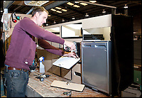 BNPS.co.uk (01202 558833)<br /> Pic: LauraJones/BNPS<br /> <br /> Cabinet assembler James Harman working on a cupboard door.<br /> <br /> The last ever delivery of brand new Volkswagen campervans has arrived in Britain marking the end of an era for the iconic 'hippy bus'.<br /> <br /> Ninety nine of the final batch of vans rolled off the production line and onto a container ship bound for British shores after manufacture ceased for good in Brazil in December.<br /> <br /> And though the consignment has only just arrived, almost all of the vans have already been snapped up by eager buyers happy to fork out the &pound;35,000 starting price.<br /> <br /> They are the last brand new campers in all of Europe.