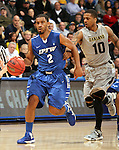 SIOUX FALLS, SD - MARCH 10:  Pierre Bland #2 from IPFW pushes the ball past Duke Mondy #10 from Oakland in the second half of their quarterfinal game Sunday night at the 2013 Summit League Basketball Tournament in Sioux Falls, SD.  (Photo by Dave Eggen/Inertia)