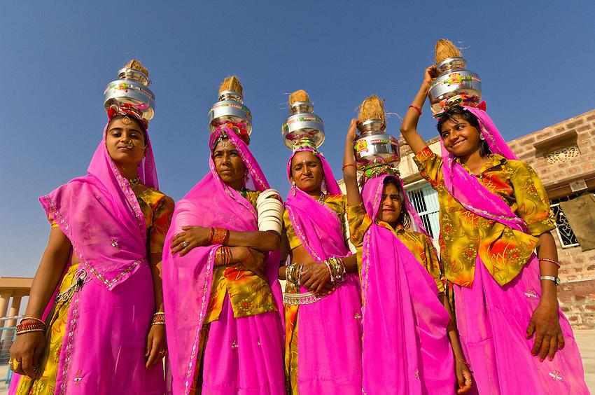 Group of women walk through the Sachiya Mata Temple during a Hindu haircutting ceremony (boy's first haircut, a rite of purification), Osian, Rajasthan, India