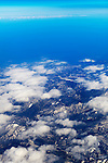 Aerial view of mountain landscape under blue sky in Japan