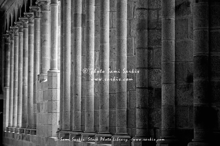 Row of columns forming the wall of the monastery, Mont Saint-Michel, Normandy, France.