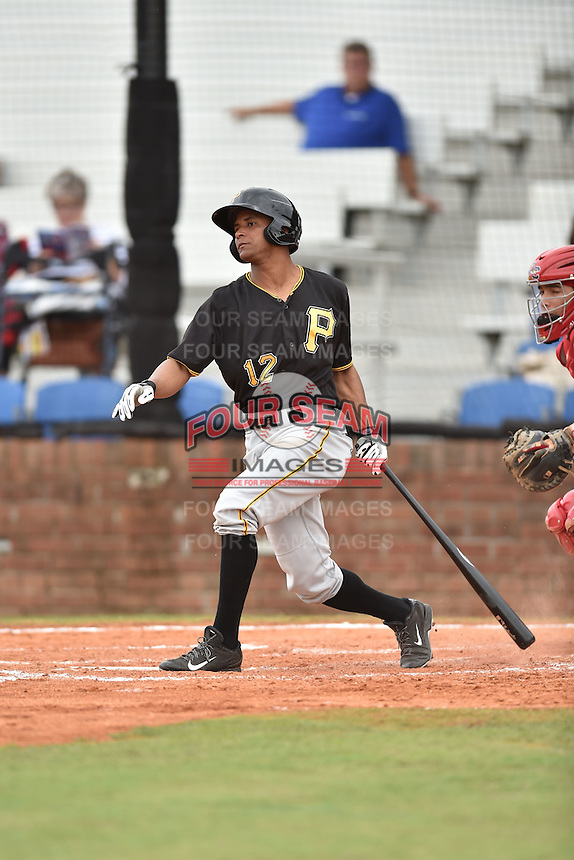 Bristol Pirates left fielder Enyel Vallejo #12 swings at a pitch during a game against the Johnson City Cardinals at Howard Johnson Field July 20, 2014 in Johnson City, Tennessee. The Pirates defeated the Cardinals 4-3. (Tony Farlow/Four Seam Images)