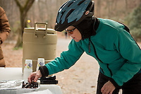 Alice Clark of center city tries out some fire-roasted chestnuts at the Winter in the Wissahickon event hosted by the Friends of the Wissahickon. (Dave Tavani/for NewsWorks)