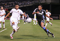 Sean Franklin (left) against Ryan Johnson (right). San Jose Earthquakes tied Los Angeles Galaxy 1-1 at the McAfee Colisum in Oakland, California on April 18, 2009.
