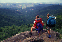 AJ2688, hiking, backpacking, hikers, Shenandoah National Park, Appalachian Trail, Virginia, Blue Ridge, Appalachian Mountains, National Scenic Trail, Two women hiking the long distance Appalachian Trail with backpacks looking out over the Shenandoah National Park in the state of Virginia.