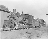 Fireman side view of C-19 #340 and K-27 #456 beside Montrose engine house.<br /> D&amp;RGW  Montrose, CO
