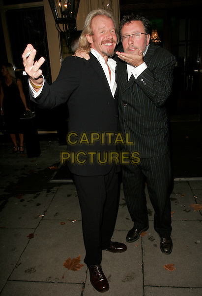 ROLAND RIVRON & GUEST.Specsavers Spectacle Wearer Of The Year 2007 - Awards,.The Waldorf Hilton Hotel, London, England, .October 9, 2007..full length funny hands glasses.CAP/AH.©Adam Houghton/Capital Pictures.