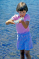 H00147.tif   Young girl with trout just caught. Willamette River, Oregon