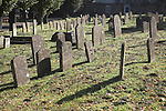Ancient weathered gravestones in churchyard near the cathedral in the centre of Bury St Edmunds, Suffolk, England
