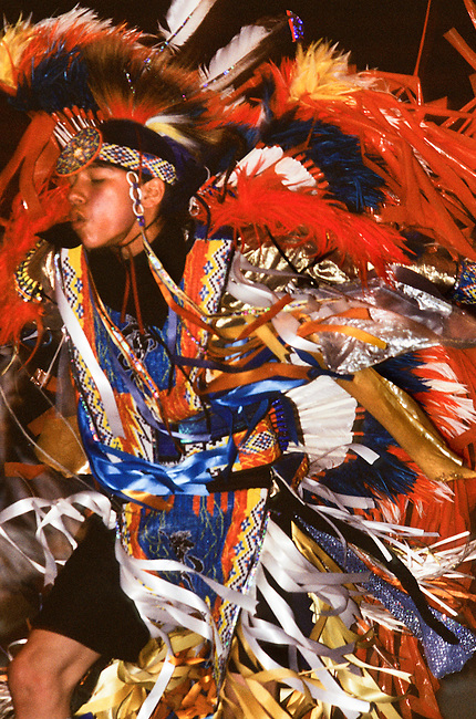 Fancy Dancer dressed in colorful regalia during the Red Earth Indian Festival pow wow, Oklahoma City OK.