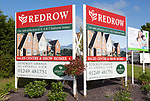 Redrow advertising poster signs for new housing for sale at Cherhill View, Stockley Grange, near Calne, Wiltshire, England, UK