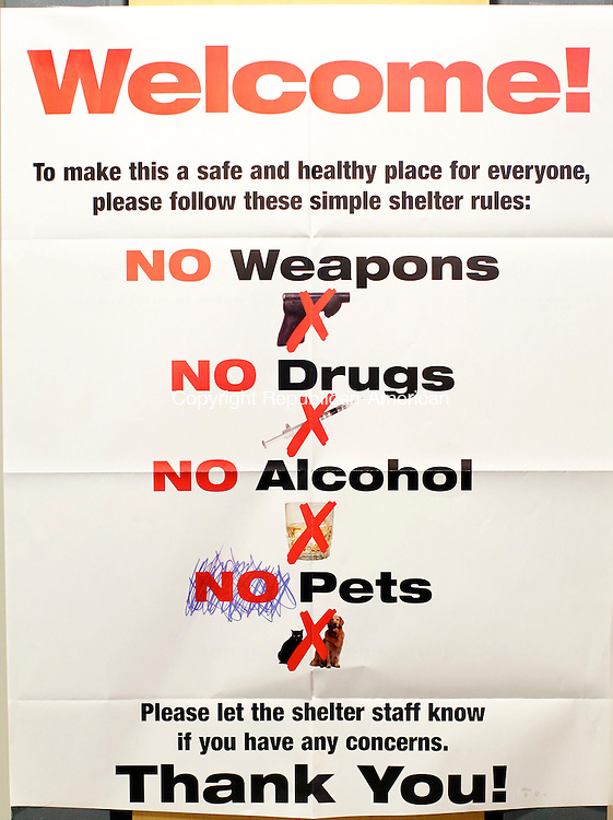 """Ridgefield, CT-02 November 2012-110212CM03-  A sign hangs inside a shelter at Ridgefield Recreational Center Friday afternoon in Ridgefield.  Crossed out at the bottom is """"No Pets"""", a ban which has been lifted to allow residents staying at the shelter to bring their pets in.  Christopher Massa Republican-American"""
