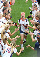 The University of Virginia women's lacrosse player Liz Downs runs through the huddle at the start of their first game since the tragic death of teammate Yeardley Love Sunday May 16, 2010 at Klockner Stadium in Charlottesville, Va. The Cavaliers rallied in the last four minutes to beat Towson 14-12 and reach the quarter finals of the NCAA tournament. Love's body was found May 3, and Virginia men's lacrosse player George Huguely is charged with murder. Photo/Andrew Shurtleff..