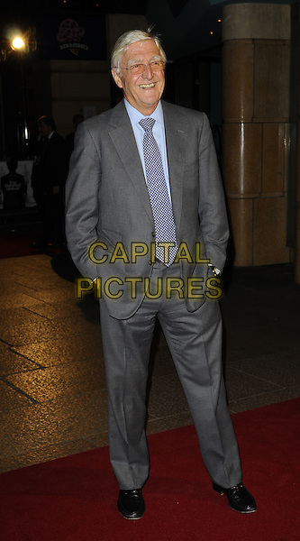 "SIR MICHAEL PARKINSON.World Premiere of ""The Damned United"" at the Vue West End, Leicester Square, London, England..March 18th 2009.full length blue tie grey gray suit hands in pockets.CAP/CAN.©Can Nguyen/Capital Pictures."
