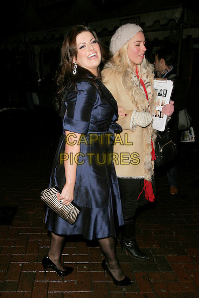 "JODIE PRENGER.The After Party for ""Clubbed"" Gala Screening at Ruby Blue in Leicester Square, London, England..January 7th 2009.full length blue dress walking laughing  wrap silk sash belted black shoes clutch bag purse .CAP/AH.©Adam Houghton/Capital Pictures."