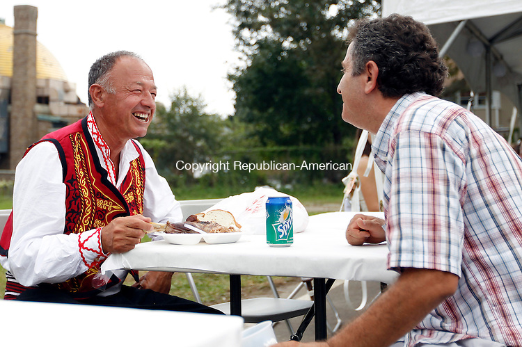 Waterbury, CT- 04, September 2011-090411CM11  Fapmir Fila (left) shares a laugh with Adem Belliu, both from Bronx, NY, during the First Annual Labor Day Festival at the Albanian Cultural Center in Waterbury.  Filla a dancer with the Bashkimi Kombetar out of the NY team was enjoying a lamb dish for lunch.   Christopher Massa Republican-American