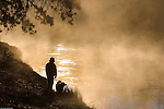 Man and his dog enjoying the Deschutes River, La Pine State Park, Oregon