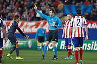 Referee Stark shows a yellow card to Olympiacos´s Fuster during Champions League soccer match between Atletico de Madrid and Olympiacos at Vicente Calderon stadium in Madrid, Spain. November 26, 2014. (ALTERPHOTOS/Victor Blanco) /NortePhoto
