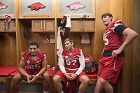 Hawgs Illustrated /BEN GOFF @NWABENGOFF<br /> C.J. O'Grady (from left), tight end from Fayetteville, Jack Kraus, tight end from Bentonville, and Cole Kelley, quarterback from Lafeyette, La., hang out in the locker room Saturday, Aug. 5, 2017, during Arkansas football media day at the Fred W. Smith Football Center in Fayetteville.