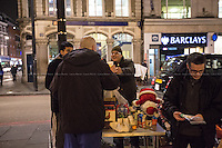 London, 16/12/2015. This evening, members of the public lead by &quot;Street Kitchens&quot; - a non-profit organisation that provides information and help for homeless people - met outside Camden Town Station for &quot;distributing and collecting essential items to those who may need them on our streets&quot;. Around 8:30PM, a small group of people moved towards King's Cross and Euston stations trying to help homeless people outside two of the major London's train stations. Wool hats, gloves, jumpers, trousers, shoes, tooth paste and brushes, coats, and then cups of tea and hot soups, sandwiches, water, bowls of rise, biscuits and a lot of company and smiles were donated this evening to the homeless people who are facing the London's cold winter. <br />