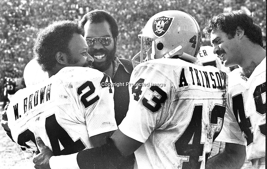 Oakland Raiders congratulate Willie Brown #24, after intercepting pass and run for TD against the Vikings in the Super Bowl. George Atkinson and Mike Siani. <br />
