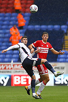 Bolton Wanderers' Gary Madine vies for possession with Middlesbrough's Dael Fry<br /> <br /> Photographer Juel Miah/CameraSport<br /> <br /> The EFL Sky Bet Championship - Bolton Wanderers v Middlesbrough - Saturday 9th September 2017 - Macron Stadium - Bolton<br /> <br /> World Copyright &copy; 2017 CameraSport. All rights reserved. 43 Linden Ave. Countesthorpe. Leicester. England. LE8 5PG - Tel: +44 (0) 116 277 4147 - admin@camerasport.com - www.camerasport.com
