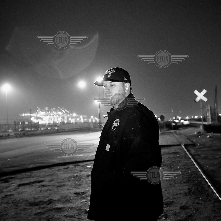 Longshoreman Virgil Maldenado in front the cranes of Global Docks, Bayonne, New Jersey. The docks of New York and New Jersey have for generations been synonymous with organised crime, with the Genovese family in control of the New Jersey waterfront and the Gambinos in control of the New York side.