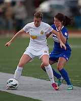 In a National Women's Soccer League Elite (NWSL) match, the Boston Breakers defeated the Western New York Flash  2-1, at Dilboy Stadium on May 5, 2013.   Western New York Flash forward Adriana Martin (8) defends the ball from Boston Breakers midfielder Jo Dragotta (25).