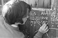 Writing on the wall.  Class is taken out to explore the locality, Whitworth Comprehensive School, Whitworth, Lancashire.  1970.