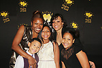 Deborah Koenigsberger - Founder & CEO of Hearts of Gold with Estephanie and family (mother of the year) at annual All That Glitters Gala - 24 years of support to New York City's homeless mothers and their children - (VIP Reception - Silent Auction) was held on November 7, 2018 at Noir et Blanc and the 40/40 Club in New York City, New York.  (Photo by Sue Coflin/Max Photo)