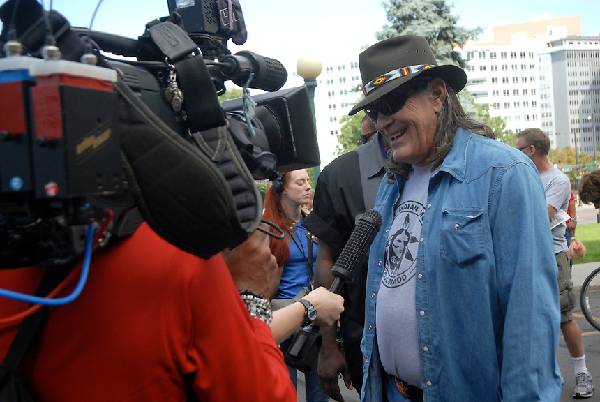 24 Aug 08: Former University of Colorado professor Ward Churchill speaks to a reporter at the Colorado state capitol building. On the day before the Democratic National Convention is scheduled to begin about 1,500 people participated in the ReCreate 68 rally, which included a march from the Colorado state capitol building to the Pepsi Center.