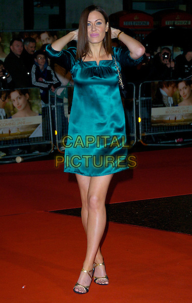 "LINZI STOPPARD.""Becoming Jane"" World Premiere, Odeon West End, .London, England, March 4th 2007..full length teal blue satin dress gold strappy sandals shoes hands on head.CAP/CAN.©Can Nguyen/Capital Pictures"