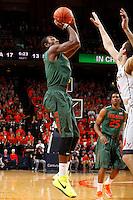 Miami guard Davon Reed (5) shoots over Virginia forward Evan Nolte (11) during an NCAA basketball game Saturday Feb, 24, 2014 in Charlottesville, VA. Virginia defeated Miami 65-40.