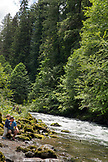 USA, Oregon, Santiam River, Brown Cannon, a man and his son fishing along the Santiam River in the Willamete National Forest