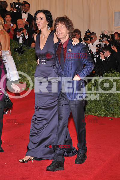 L'Wren Scott and Mick Jagger at the 'Schiaparelli And Prada: Impossible Conversations' Costume Institute Gala at the Metropolitan Museum of Art on May 7, 2012 in New York City. © mpi03/MediaPunch Inc.